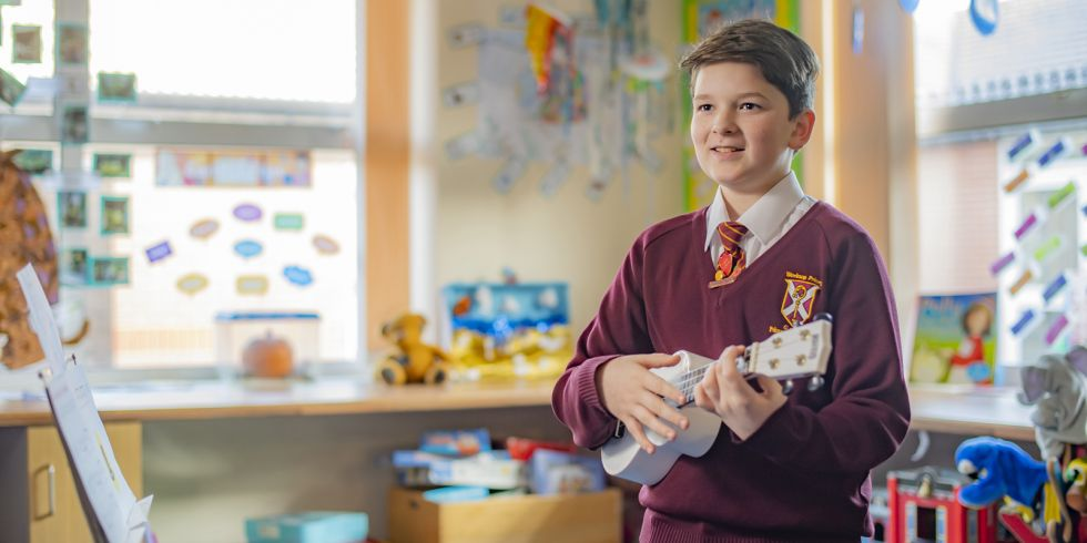 Harry Bagshaw of Worksop Priory C of E School, Children's University graduate playing the ukulele